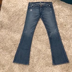 A pair of all man kind 7 jeans that are boot cut